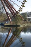 Spreepark Berlin. Old Ferris wheel in an abandoned amusement park reflected in water Stock Images