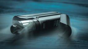Sprejflaska på en blå bakgrund Fotografering för Bildbyråer