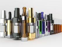 Sprejflaskor, clearomizers och ejuice Royaltyfri Fotografi
