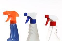 Sprejflaskor på vit arkivfoton