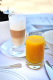 Spremuta e caffè Fotografie Stock Libere da Diritti