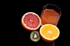 Spremuta Mixed dell'arancio, del kiwi e di pompelmo Fotografia Stock