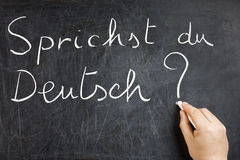 Sprichst du在黑板的德意志Question 免版税库存图片