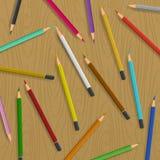 Spridda blyertspennor på tabellvektorbakgrund Arkivbilder