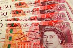 Spridning av ett pund sterling 50 pund anmärkningar Arkivbilder