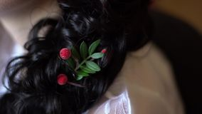 Sprig with a berry as a decoration in the hair. Clouse-up stock video footage