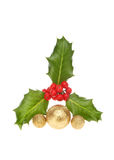 Sprig of holly with baubles royalty free stock images