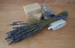 Sprigs of Lavender and Four Soap Bars. Close up of handmade goats milk soap with a bar of lavender soap with purple swirls on a folded ramie washcloth. A bouquet stock images