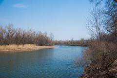 Sprin flood on river. Plain river in the spring royalty free stock photography