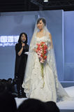Spring 2011 China (Guangzhou) Wedding Expo. Chinese model display wedding dress in Spring 2011 China (Guangzhou) Wedding Expo,show time from March 12 to 13 Royalty Free Stock Image
