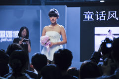 Spring 2011 China (Guangzhou) Wedding Expo. Chinese model display wedding dress in Spring 2011 China (Guangzhou) Wedding Expo,show time from March 12 to 13 Stock Photography