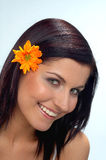 Spring. Happy woman with orange flower stock image