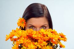 Spring. Young woman with orange flowers royalty free stock photos