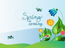 Spring. Theme with flowers and two bees Royalty Free Stock Image