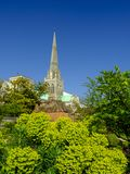 Spring afternoon sunshine on Chichester cathedral from Bishop`s Palace Gardens, Chichester, West Sussex, UK. Chichester, UK - May 28, 2018: Spring afternoon stock images