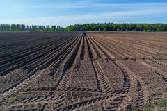 Spring agricultural plowed field. Royalty Free Stock Photography