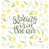 Spring is in the air - floral greeting card with lettering vector stock illustration