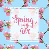 Spring is in the air. Hand drawn brush pen lettering on flower magnolia tree pattern. stock illustration