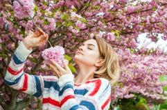 Spring allergy. Beautiful woman enjoying nature blooming tree. Beautiful woman enjoying nature blooming tree. Spring allergy concept royalty free stock photo