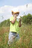 Spring allergy. Boy sneezing because of pollen allergy in a garden in the spring Stock Images
