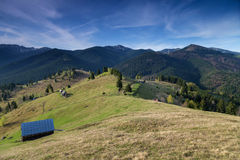 Spring alpine landscape with green fields in Transylvania, Romania Royalty Free Stock Images