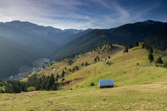 Spring alpine landscape with green fields in Transylvania, Romania Royalty Free Stock Image