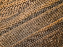 Spring arable land. Field and beautiful patterns from the tractor. View from above.n. Spring arable land.  View from above. Field and beautiful patterns from the Royalty Free Stock Image