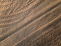 Spring arable land. Field and beautiful patterns from the tractor. View from above.n. Spring arable land.  View from above. Field and beautiful patterns from the Stock Photos