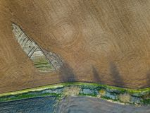 Spring arable land. Field and beautiful patterns from the tractor. View from above.n. Spring arable land.  View from above. Field and beautiful patterns from the Royalty Free Stock Photo