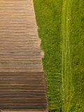 Spring arable land. Field and beautiful patterns from the tractor. View from above.n. Spring arable land.  View from above. Field and beautiful patterns from the Royalty Free Stock Photography