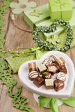 Spring arrangement with chocolate pralines Royalty Free Stock Photos