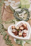 Spring arrangement with chocolate pralines Stock Photography
