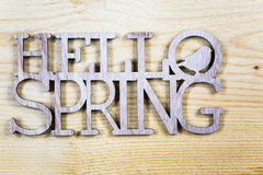 Spring as text written on wooden background with butterfly, symb Royalty Free Stock Photography