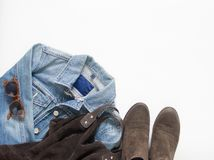 Spring, autumn female outfit. Set of clothes, shoes and accessories on white background. Blue denim jacket, brown bag and shoes. stock photos