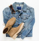 Spring, autumn female outfit. Set of clothes, shoes and accessories on white background. Blue denim jacket and camel shoes. royalty free stock photo