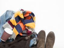 Spring, autumn female outfit. Set of clothes, shoes and accessories on white background. Blue denim jacket, stripe scarf, brown ba royalty free stock photo