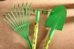When the spring or autumn season comes, it`s time to organize the garden. During cleaning works, various garden tools are useful which shorten the working time Royalty Free Stock Photos
