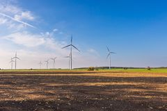 Spring or autumnal landscape with windmills on fields Stock Photos