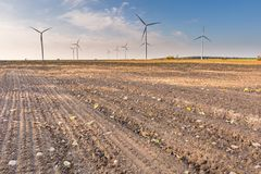 Spring or autumnal landscape with windmills on fields Stock Photography