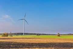 Spring or autumnal landscape with windmills on fields Royalty Free Stock Image