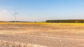 Spring or autumnal landscape with windmills on fields Royalty Free Stock Photo