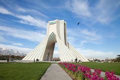 Spring in Azadi Square of Tehran. TEHRAN - APRIL 1: Azadi Square decorated with grass and flowers in springtime on April 1, 2014 in Tehran, Iran. Azadi Monument royalty free stock photography