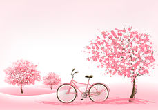 Spring background with a blossoming tree and a bike. Stock Image