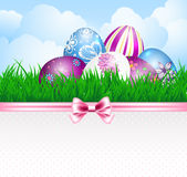 Easter eggs and ribbon Stock Photos