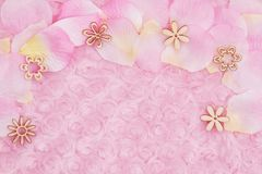 Spring background with a flower petals on pale pink rose plush fabric. Spring background with a flower petals and wood petals on pale pink rose plush fabric with stock images