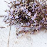 Spring background with flowers. On a wooden background close up royalty free stock image