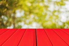Spring background light bokeh adn red wood. Spring background light bokeh with a red wooden floor Royalty Free Stock Photos