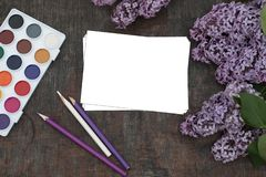 Spring Background in lilac tones with white sheet of paper for writing greetings or notes stock photo