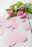 Spring background with pink tulips and hearts Royalty Free Stock Images