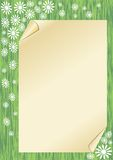 Spring background with a sheet old paper with rolled corners on green area Stock Images